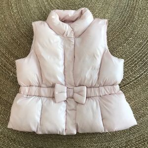 Baby Gap light pink puffer vest w/ bow.